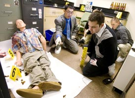 Dr. Hsieh teaches his students in the mock crime scene